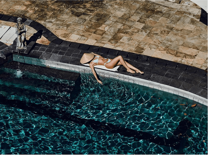 candice swanepoel pool tanning instagram