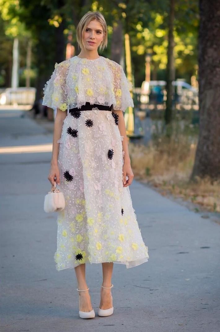 Elena Perminova weairng a pastel floral-appliqued midi dress